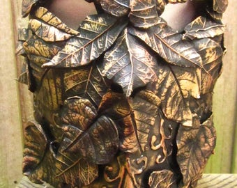 The Verdant Horseman, Full faced paper mache mask with Hand formed Leaves in various shades of metal gilding