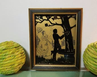 "Vintage Silhouette Couple ""Hearts"" Deltex Products Co., No. 2020 Series. Carving hearts in tree. Reverse painting on glass. Sweethearts."