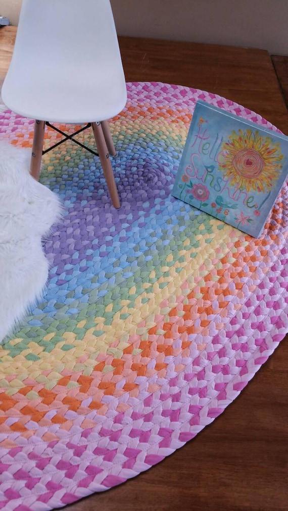 pastel rainbow braided rug , lavender, light blue, pistchio, yellow, peach  and pink