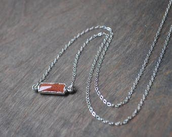 Tiny Goldstone Necklace in Silver