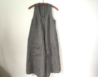 flowing a-line gray and white striped linen dress with pockets racer back and shirt tail hem