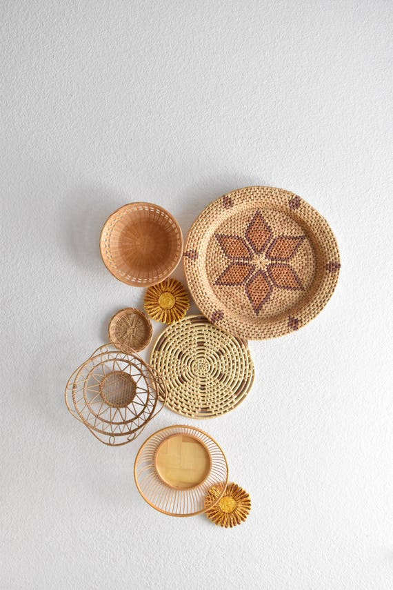 RESERVED // vintage set of 7 straw rattan wall baskets