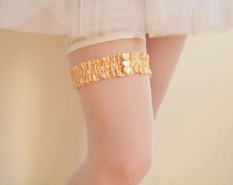 Beige Liberty bridal garter - size small