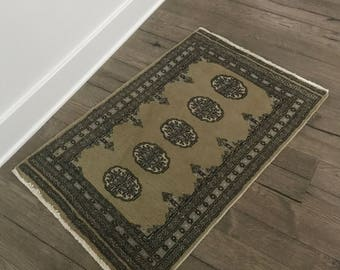Small vintage 2 x 3 olive green and blue Bokhara Pakistan area rug with elephant print design
