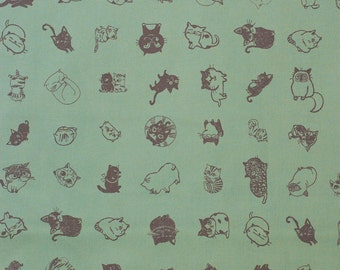 Japanese kawaii cat fabric in green oxford cotton by Shinzi Katoh - 1/2 YD