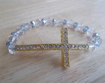 Clear Crystal Stretch Bracelet with a Gold and Clear Rhinestone Cross
