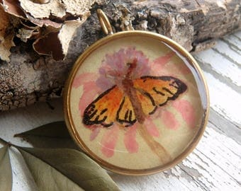 Monarch Butterfly- art resin pendant original painting. pink coneflower. resin butterfly pendant. goldtone bezel. Jettabugjewelry