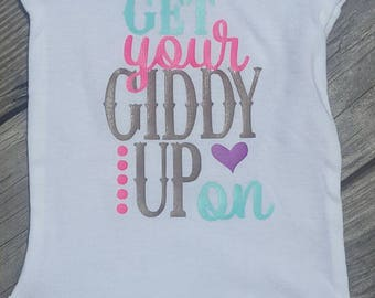 Get your giddy up on baby girl rodeo onesie