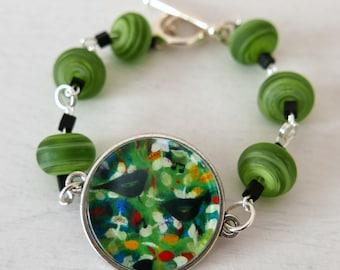 Green Bracelet, Bird Bracelet, Bracelet with Naive Art Print, Green Lampwork Beads, Quirky Jewelry, Art Bracelet, Art Jewelry