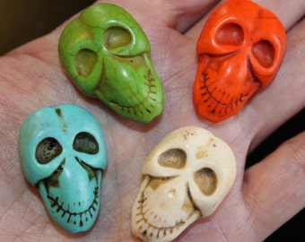 4 natural turquoise gemstone beads, dyed, Skulls, 32 mm x 22 mm x 11 mm, hole 1 mm, 1 each of orange, green, blue, and cream