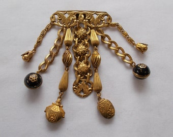 Gold Tone Costume Fur/Clothing Clip with seven dangles.  (750)