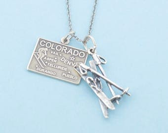 Colorado charm pendant with downhill skis in sterling silver on stainless steel chain.  Colorado jewelry.  Colorado Rockies.  Ski necklace.