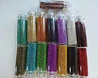 10 Glass Bottles filled with 0.7mm Glass Caviar Beads (no hole). Ideal for manicure or pedicure, pottery and crafts. Randomly Mixed Bottles