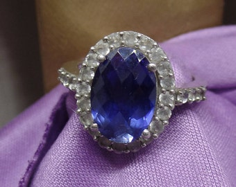 Sterling Silver Ring with Synthetic Sapphire and clear topaz stones size 7 marked 925