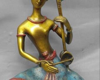 Vintage brass Asian man musician playing an Erhu figure sculpture statue