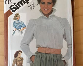 Simplicity 5575 - 1980s Loose Fitting Blouse with Round Yoke and Standing Collar with Asymmetrical Ruffle Trim Option - Size 10 Bust 32.5