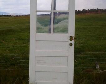 Vintage salvaged door with 4 pane window