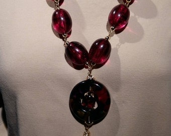 Big and bold necklace reclaimed material, cranberry red, trendy and chic
