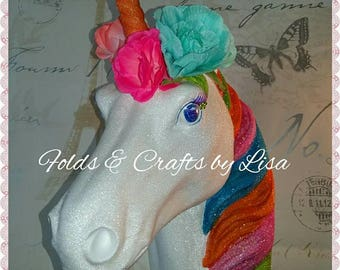 Stunning wall mounted unicorn head glittered with flower garland.