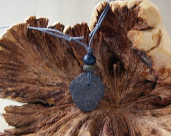 Beach pebble pendant on dark grey cotton cord adjustable necklace with wooden beads