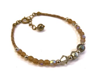 Beaded bracelet in sophisticated earth tones, silver, gunmetal, taupe
