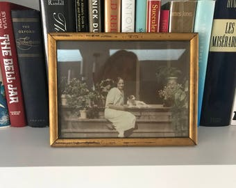 Vintage black and white sepia photo lady with spaniel in gold frame