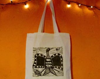 flying bird hand printed lino cut tote bag inspired by african tribal art of Senufo people linoprint quirky unusual tote bag
