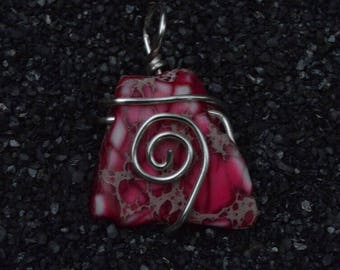 Wire wrapped pink stone bead pendant