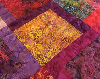 Batik crazy describes this queen size quilt.