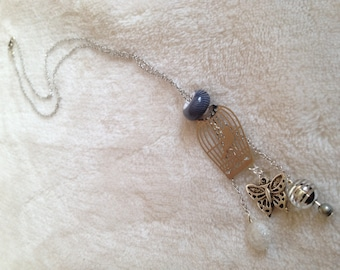 Women silver necklace. Silver chain, silver pattern bird cage topped with a Pearl gray. 3 pendants