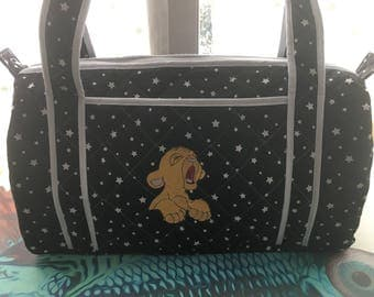 Changing bag in lined quilted fabric.
