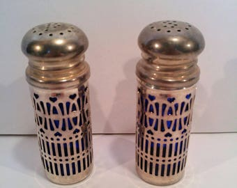 Cobalt glass and UK Silverplate heart pattern salt and pepper shakers.