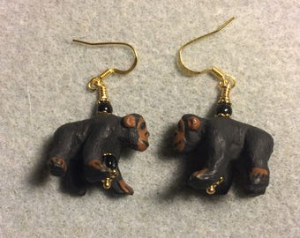 Black and brown ceramic chimpanzee bead dangle earrings adorned with black Czech glass beads.