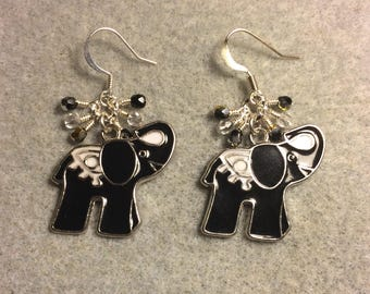 Black and white enamel elephant charm earrings adorned with tiny dangling black and clear Czech glass beads.