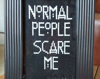 American Horror Story inspired 'normal people scare me' completed cross stitch.