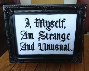 Beetlejuice inspired 'I, myself, am strange and unusual' completed cross stitch.