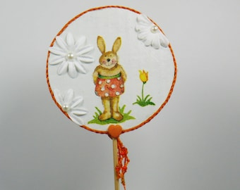 Decorative spike orange rabbits with flowers and hearts