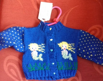 Hand knitted cardigan to fit a baby girl aged 0-3 months old