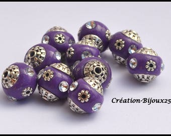 A purple round Indonesian bead 18 mm silver rhinestone