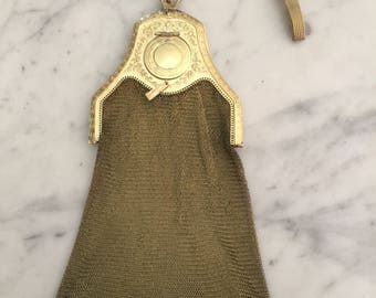 Antique gold colour mesh wrist purse with bead clasp, tassels and inbuilt mirror compact. Perfect evening bag.