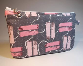 flat pouch fabric grey background with pink gloves