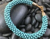 Opaque Dark Teal Kumihimo Beaded Bracelet