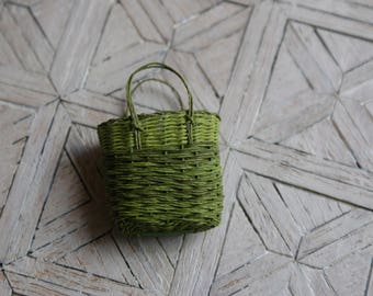 A miniature green shopping/ beach basket