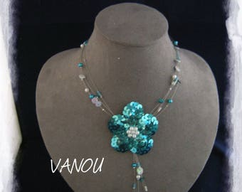 Necklace made of white turquoise beads and sequins flower