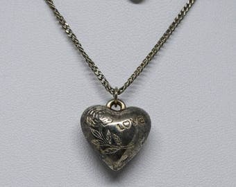 Lovely silver tone heart necklace