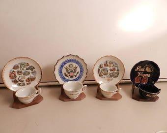 four small souvenir cup & saucer sets las begas virginia north carolina u.s.a.