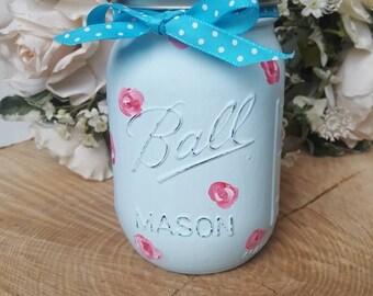 Shabby chic handpainted rose patterned mason jar.