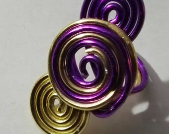 triple ring gold spirals and fuschia