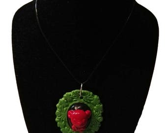 Green and black cameo with Red bear