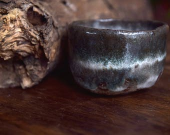 Handbuilt, dark stoneware tea bowl